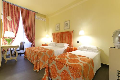 A bed or beds in a room at Relais Lavagnini Florence