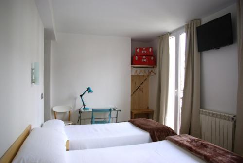 Ein Bett oder Betten in einem Zimmer der Unterkunft Pensión Balerdi