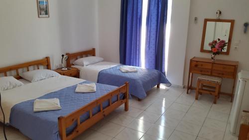Ένα ή περισσότερα κρεβάτια σε δωμάτιο στο Ξενοδοχείο Εσπερίδες