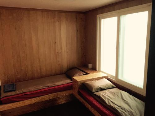 A bed or beds in a room at Bong House