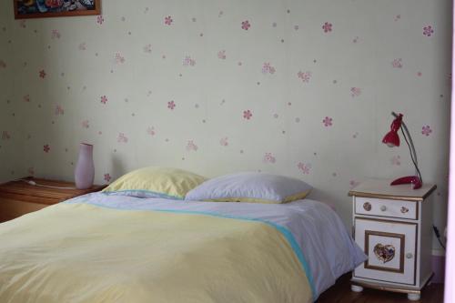 Un ou plusieurs lits dans un hébergement de l'établissement Chanteclair