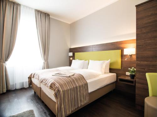 A bed or beds in a room at BATU Apart Hotel