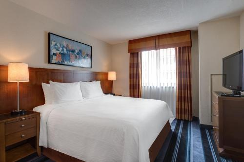 A bed or beds in a room at Residence Inn by Marriott New York Manhattan/Times Square