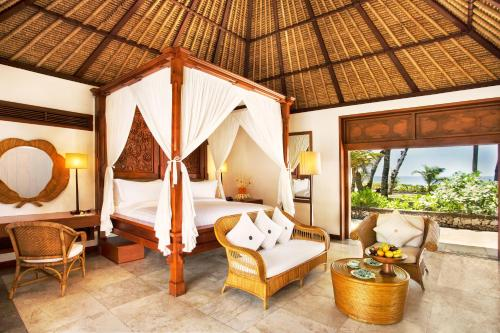 A bed or beds in a room at The Oberoi Beach Resort, Bali