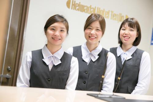 Staff members at Heiwadai Hotel Tenjin