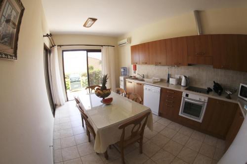 A kitchen or kitchenette at Eve Pissouri Veriko Villa