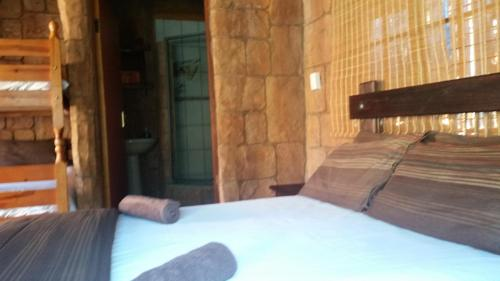 A bed or beds in a room at The Royal Gecko Bushveld Lodge