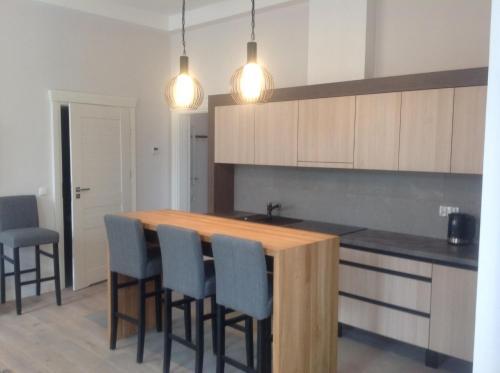 A kitchen or kitchenette at Kavo Sopot Apartment