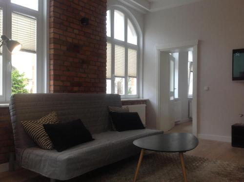 A seating area at Kavo Sopot Apartment