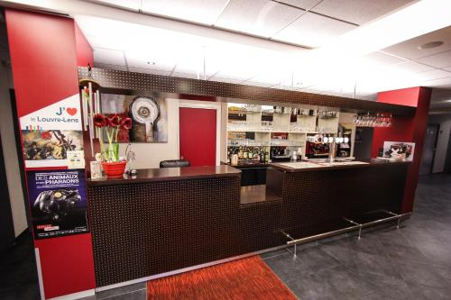 The lounge or bar area at Hotel Bollaert