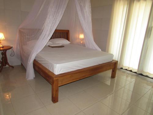 Un ou plusieurs lits dans un hébergement de l'établissement Rani Homestay