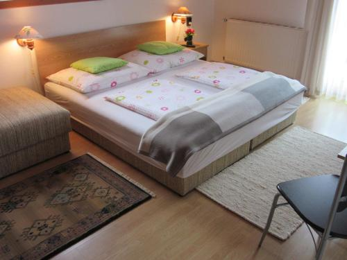 A bed or beds in a room at Zsuzsa Panzió