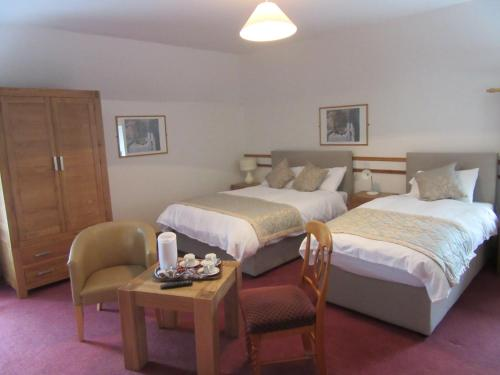 A bed or beds in a room at The Malting's B&B