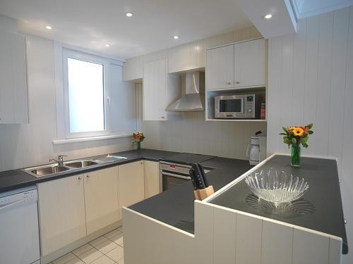 A kitchen or kitchenette at Residentie Sweetnest