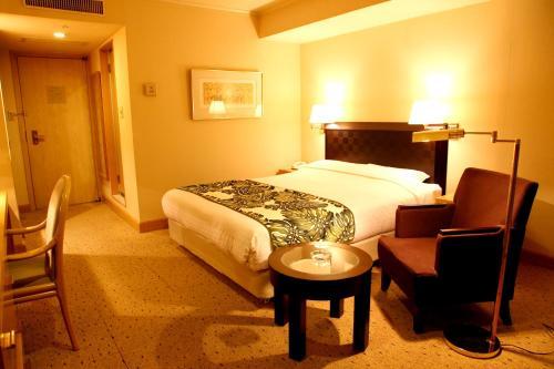 Tempat tidur dalam kamar di Breezbay Hotel Resort and Spa
