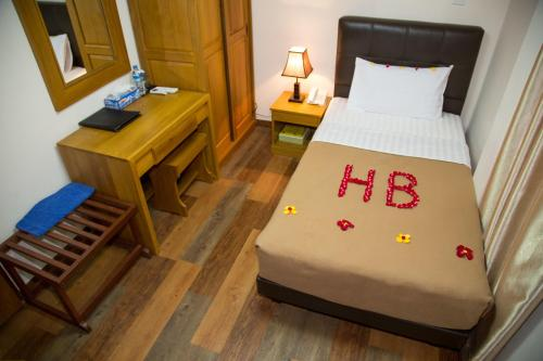 A bed or beds in a room at Hotel Bahosi