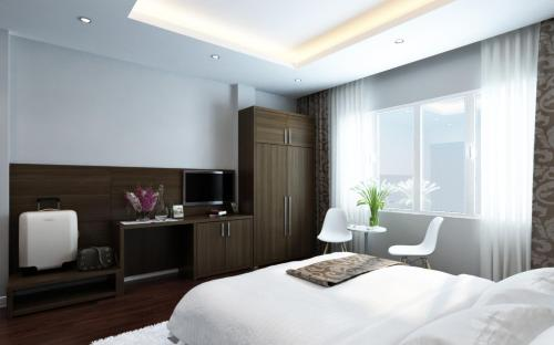 A bed or beds in a room at Eco Luxury Hanoi