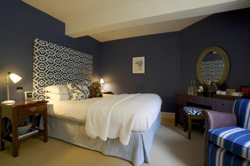 A bed or beds in a room at The Swan Hotel