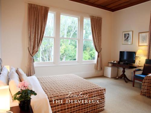 Cama o camas de una habitación en The Devereux Boutique Hotel