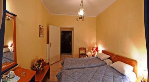 Ένα ή περισσότερα κρεβάτια σε δωμάτιο στο Hotel Marily