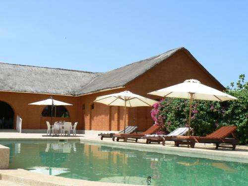 The swimming pool at or near Baobab Lodge