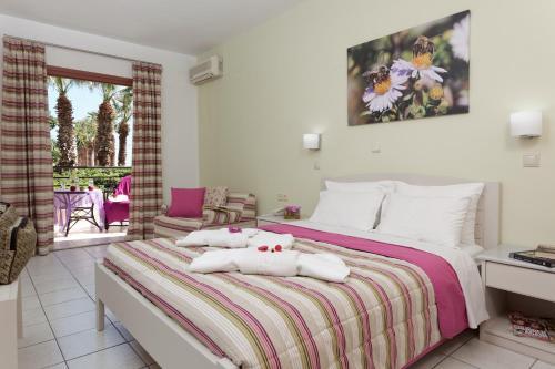 Ένα ή περισσότερα κρεβάτια σε δωμάτιο στο Latania Apartments