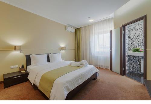 Кровать или кровати в номере Дом Отель Классик