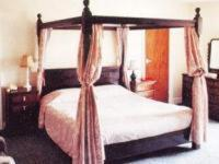 A bed or beds in a room at Maltings Hotel
