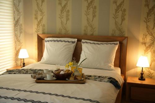 A bed or beds in a room at Alazani Valley Hotel