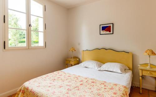 Un ou plusieurs lits dans un hébergement de l'établissement Lagrange Vacances Domaine de Fayence
