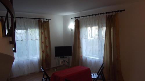 Un televizor și/sau centru de divertisment la Vila Maria