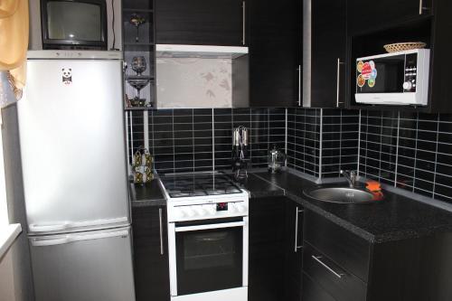 Кухня или мини-кухня в Apartment on Grazhdanskiy 114 K1