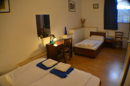 A bed or beds in a room at Apartments Golubic