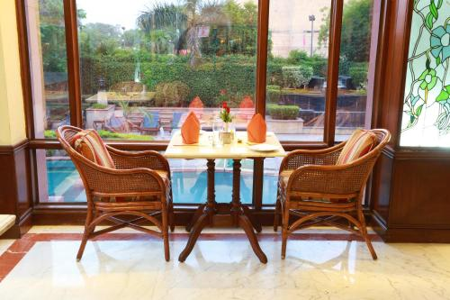 A restaurant or other place to eat at The Ashok, New Delhi