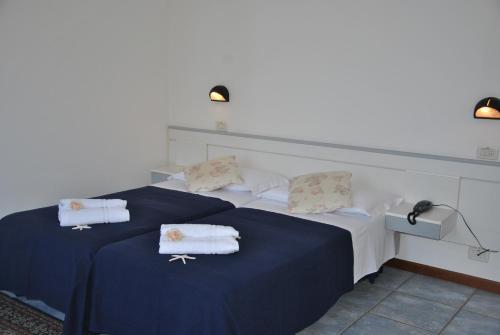Un ou plusieurs lits dans un hébergement de l'établissement Residence Du Parc