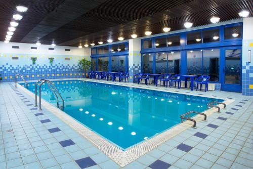 The swimming pool at or near Hotel Harmonie