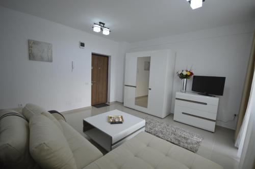 O zonă de relaxare la Ambiance Apartment