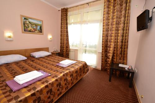 A bed or beds in a room at European Guest House