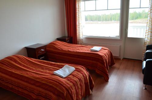 Vuode tai vuoteita majoituspaikassa Hotel Reima Country Center
