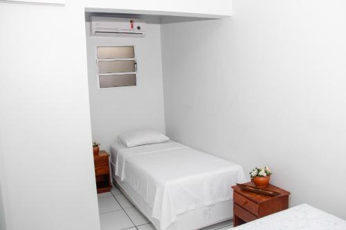 A bed or beds in a room at Novo Hotel