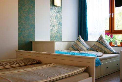 A bed or beds in a room at Apartments Rummelsburger Bucht am Ostkreuz