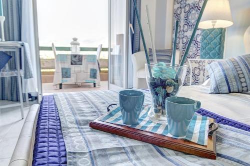 Area soggiorno di SuiteHome Taormina
