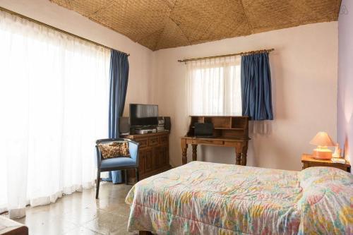Cama o camas de una habitación en Casa La Columna