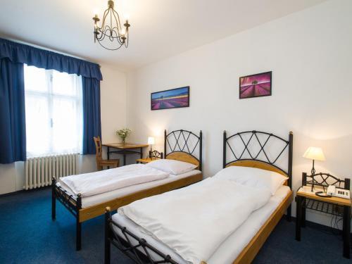Postel nebo postele na pokoji v ubytování Hotel Šumava