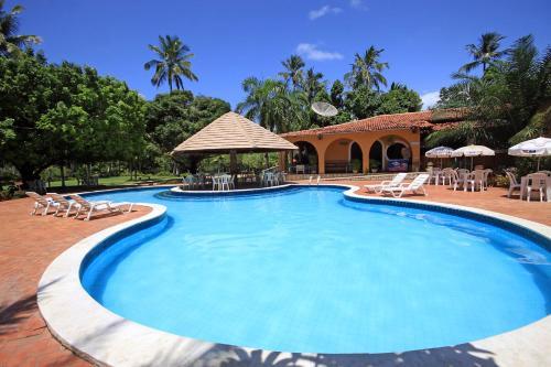 The swimming pool at or close to Pousada Paraiso dos Coqueirais