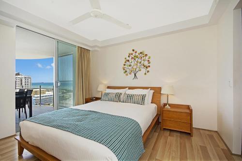 A bed or beds in a room at Aqua Vista Resort