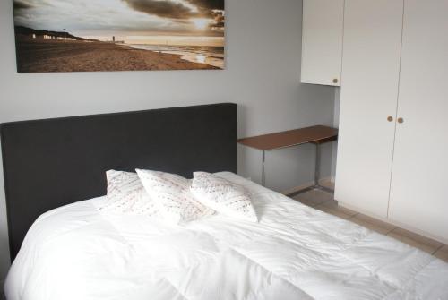 Un ou plusieurs lits dans un hébergement de l'établissement Apartment Bredene