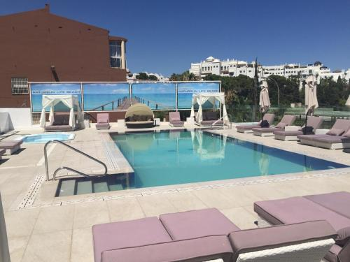 The swimming pool at or near Hotel Natursun