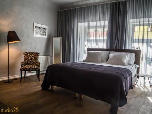 Voodi või voodid majutusasutuse Studio28 Boutique Rooms toas