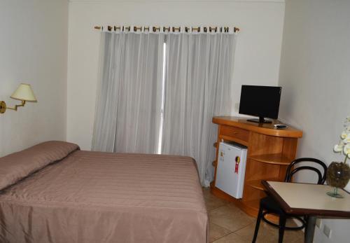 Cama ou camas em um quarto em Hotel São Luiz